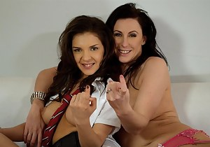 Lara Latex seduces young Henessy and has hot sex with her