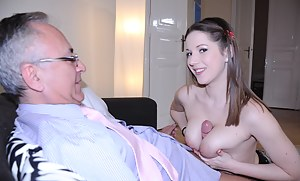 Hottie in red fishnets fucks an old cock with her big jugs