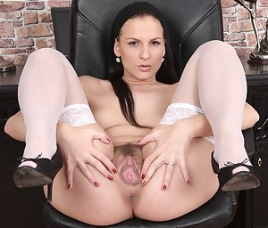 Beautiful brunette Walleria is hot and horny and strips in the home office. Her legs go on for days and lead the way to her juicy hairy twat.