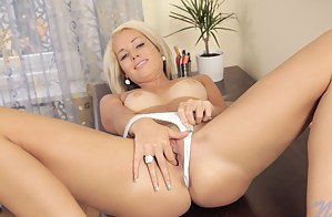 Naughty Venus Devil stuffs her fingers deep in her tight pussy
