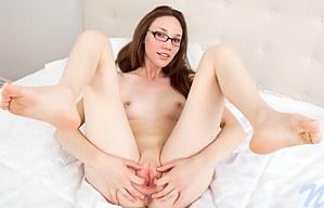 Glamorous babe Aria Amor masturbates with a purple dildo