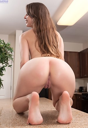 Zoey Laine hops up on the island counter and spreads her twat.