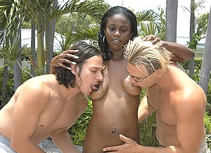 Chocolate woman is playing dirty games with two white partners. She is getting her ebony holes and mouth penetrated with their cocks.