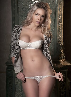 Charming blonde with amazing big boobs strips off her lingerie getting absolutely naked.