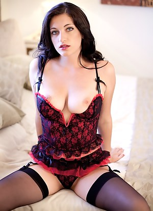 Stunning busty brunette Brook Simmons in stockings.