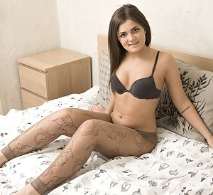 Mary K lays on her bed in lingerie and her stockings. Through the stockings, you can see her hairy pussy perfectly. She takes it all off and spreads her young legs and she shows off her pink pussy lips.