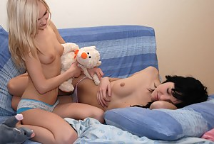 Sexy lesbian teens enjoy every second while caressing each others bodies before the camera