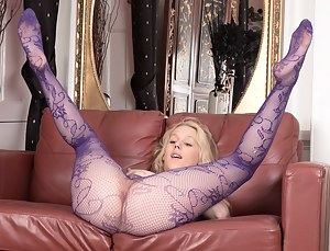 Aston Wilde looks great in her purple stockings, and shows off her young hairy pussy underneath them. She strips naked and plays with her delightful pink pussy lips and her 34C breasts to enjoy herself.