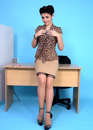 Every bosses dream secretary unwraps a Kit-Kat and her clothes!
