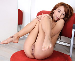 Exotic Asian Nubile Verasha strips naked and fondles her cock craving pussy
