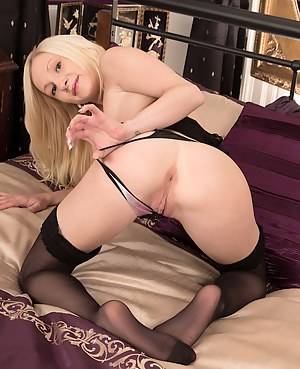 Gorgeous blond babe Chloe naked in only black stockings.