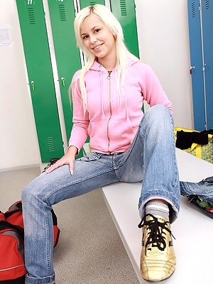 A horny sporting blonde undressing and stroking herself