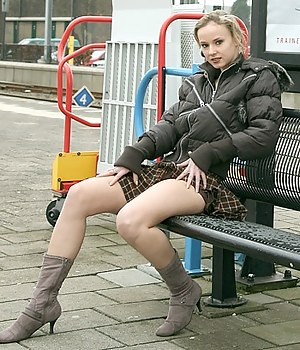 Blonde teenie flashing her body in the public transport