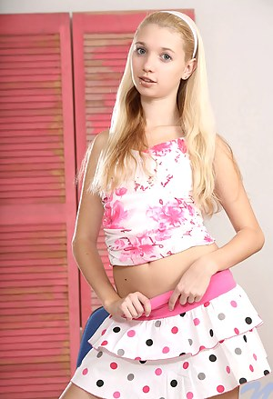 Sweet teen wearing skirt sliding it up and showing her shaved pussy