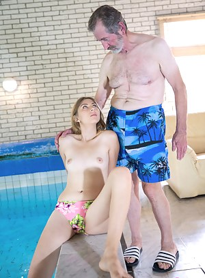 An older guy is laying by the pool but gets a hot surprise!